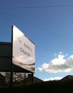 St John's sign and blue sky